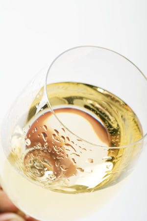 Glass of chilled white wine, close-up, high angle view