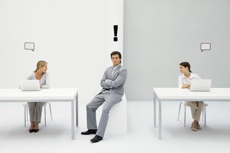 Man sitting in office with exclamation mark over his head, women on either side with blank word bubbles