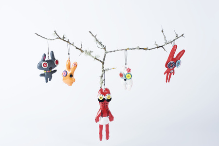 Cell phone charms hanging from branches LANG_EVOIMAGES