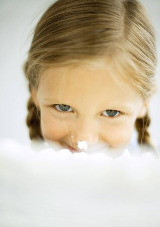 Girl biting into cake LANG_EVOIMAGES