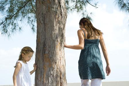 vestidos de epoca: Two sisters walking around tree, touching trunk, low angle view