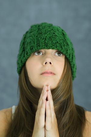 Teenage girl praying, portrait LANG_EVOIMAGES