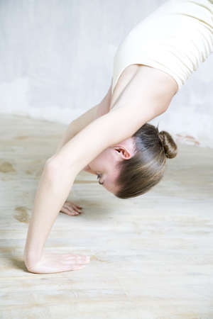 Cropped view of woman doing backbend, waist up