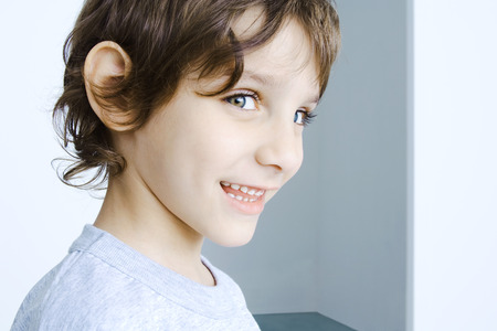 Boy smiling at camera, head and shoulders, portrait