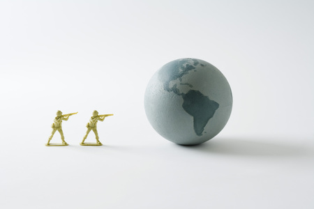 Toy soldiers aiming guns at the Earth LANG_EVOIMAGES