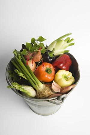 Bucket filled with assorted fresh vegetables LANG_EVOIMAGES