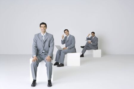 sequences: Successful businessman encouraging himself, digital composite LANG_EVOIMAGES
