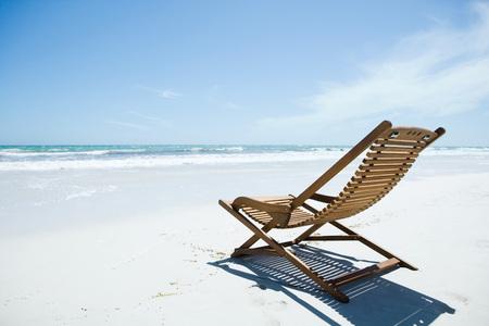 chairs: Wooden deckchair on beach
