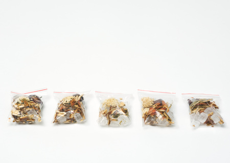 holistic view: Baggies containing chinese herbal tea mixture LANG_EVOIMAGES