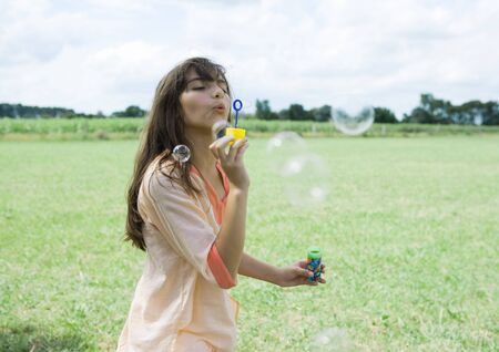 whimsy: Girl blowing bubbles