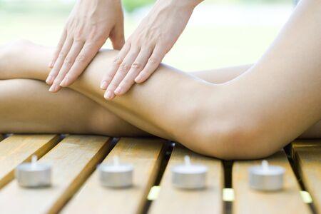 Woman receiving leg massage LANG_EVOIMAGES
