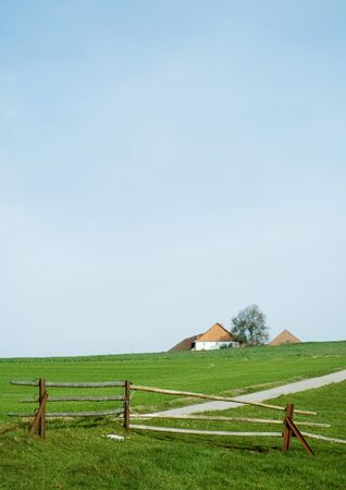 expanse: Landscape with farm house and wooden fence