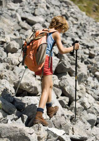 overcoming adversity: Child hiking across rocks