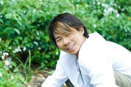 Man in garden, smiling at camera