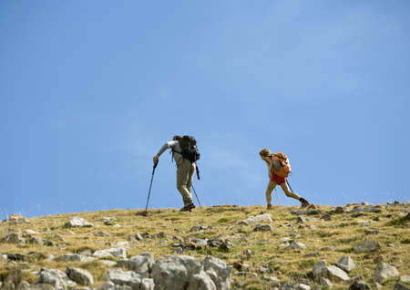 Hikers on mountainous landscape