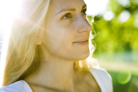 Young woman in sunlight, portrait