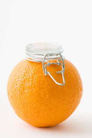 Fresh orange with canning lid on top of it