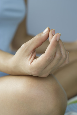 Womans hand in mudra position