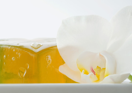 Bar of soap and orchid blossom
