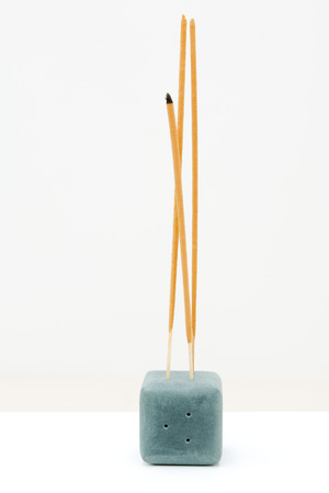 Incense sticking up out of incense holder