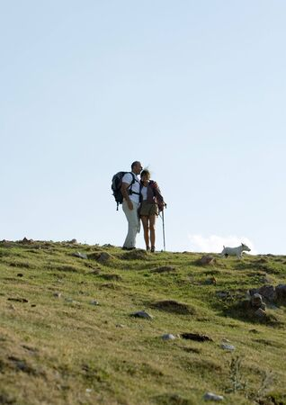 getting out: Hikers in mountainous landscape
