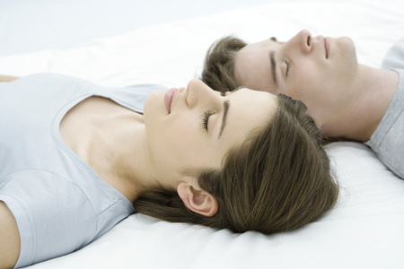 Couple sleeping, heads side by side