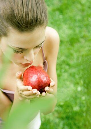 Woman kissing apple