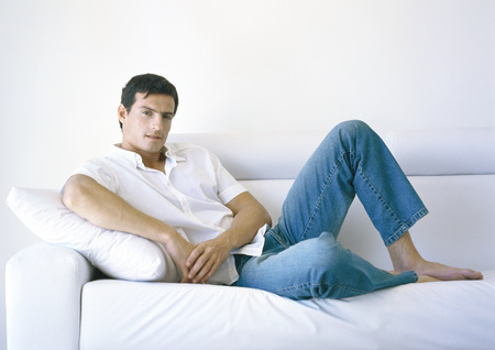 Man lounging on sofa