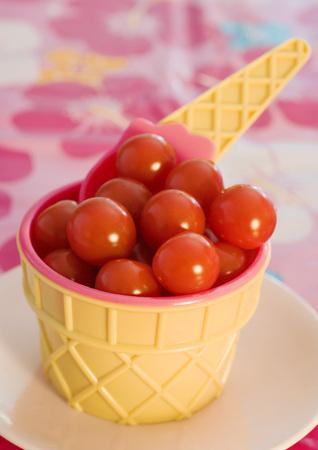 Ice cream cone bowl containing cherry tomatoes