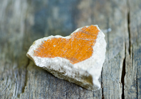 Heart shaped stone on wood surface LANG_EVOIMAGES