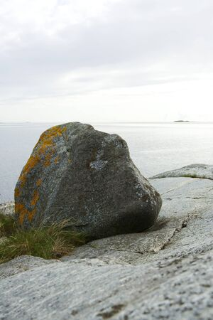 Large rock on sea shore