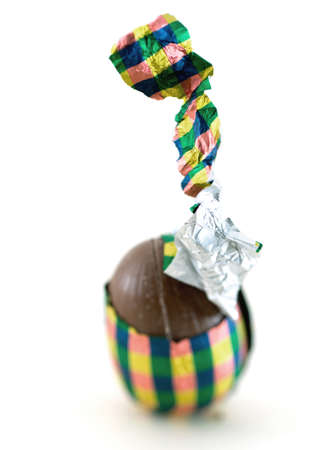 Chocolate egg, partially unwrapped LANG_EVOIMAGES