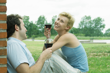 Couple drinking wine outdoors