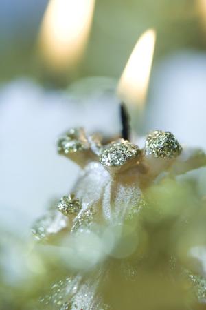 Decorative Christmas candle, lit, close-up