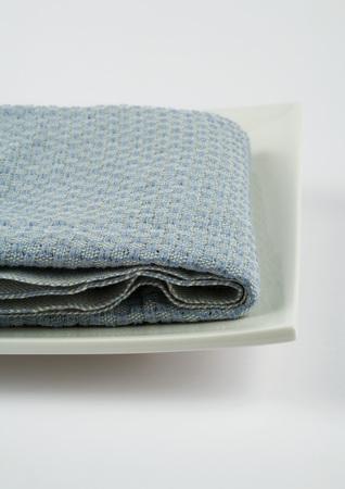 Towel folded on square dish