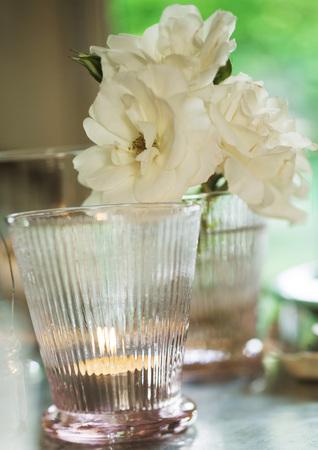 Candleholder and flower blossoms LANG_EVOIMAGES