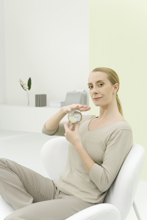 Professional woman holding crystal ball, smiling at camera LANG_EVOIMAGES