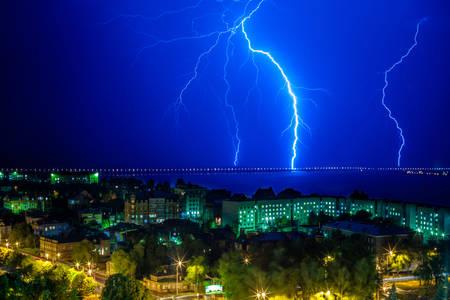 lightning strike: Lightning flashed near the bridge over the river Stock Photo