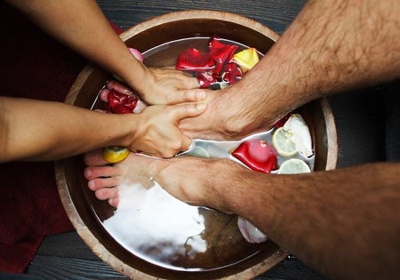 parlor: male foot massage Stock Photo