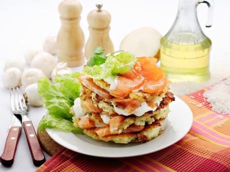prepared fish: rice pancake with smoked salmon