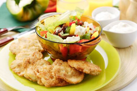 chicken cutlets with salad served for dinner photo