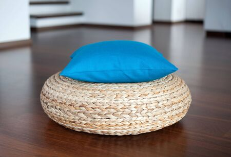Blue decorative pillow in interior Stock Photo