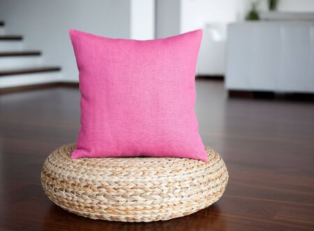 home accent: Pink pillow in white interior. Decorative pillow for home decor. Accent pillow in interior.