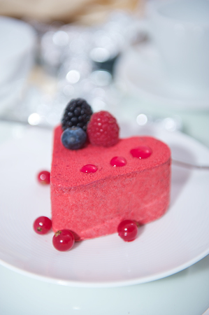 Heart shaped cake dessert on a blurred background