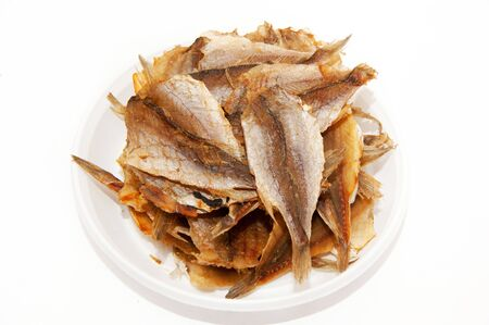 Fish snacks for beer on a plate on a white background
