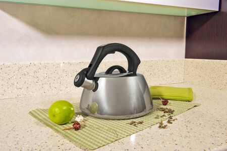 metal Kettle on a table on a napkin
