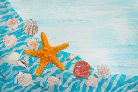 Sea background with blue wood, starfish, shells