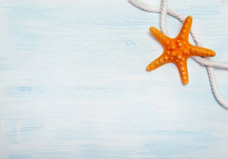 Sea background with blue wood, rope, starfish, Stock Photo