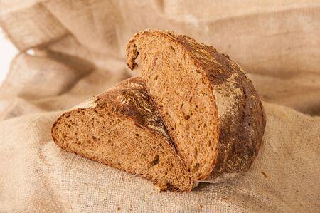 rye black bread on burlap background