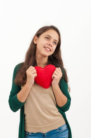 Teen girl with a plush toy heart